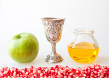 Rosh hashana Kiddush cup honey pomegranate and apple. Rosh hashana Kiddush cup honey pomegranate and green apple Stock Photos