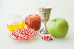 Rosh hashana Kiddush cup honey pomegranate and apple. Rosh hashana Kiddush cup honey pomegranate and green apple Royalty Free Stock Images