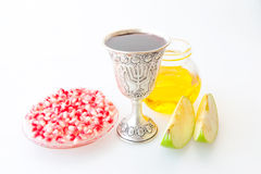 Rosh hashana Kiddush cup honey pomegranate and apple Stock Photography