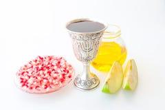 Rosh hashana Kiddush cup honey pomegranate and apple. Rosh hashana Kiddush cup honey pomegranate and green apple Stock Photography