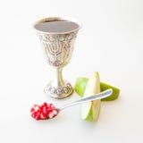 Rosh hashana Kiddush cup pomegranate and apple Royalty Free Stock Photo