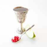 Rosh hashana Kiddush cup pomegranate and apple Royalty Free Stock Images