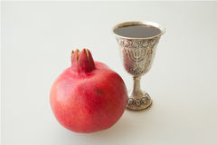 Rosh hashana Kiddush cup pomegranate. Rosh hashana Kiddush cup and pomegranate seeds on a plate Stock Images