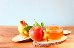 Rosh hashanah concept - apple honey and pomegranate over wooden table. Stock Images
