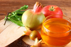 Rosh hashanah concept - apple honey and pomegranate over wooden table Stock Image