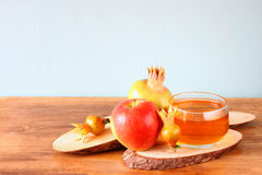 Rosh hashanah concept - apple honey and pomegranate over wooden table Royalty Free Stock Photo