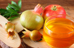 Rosh hashanah concept - apple honey and pomegranate over wooden table. Stock Photo