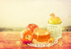 Rosh hashanah concept - apple honey and pomegranate over wooden table Stock Photography