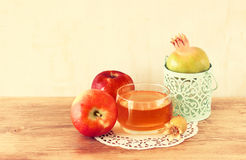 Rosh hashanah concept - apple honey and pomegranate over wooden table. Royalty Free Stock Photos