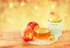 Rosh hashanah concept - apple honey and pomegranate over wooden table Stock Images