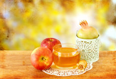 Rosh hashanah concept - apple honey and pomegranate over wooden table. Royalty Free Stock Image