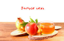 Rosh hashanah concept - apple honey and pomegranate over wooden table. isolated Royalty Free Stock Photography