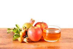 Rosh hashanah concept - apple honey and pomegranate over wooden table. isolated. Stock Photos