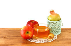 Rosh hashanah concept - apple honey and pomegranate over wooden table. isolated Royalty Free Stock Photos