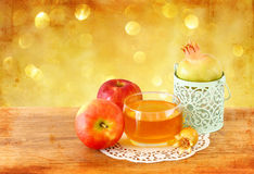 Rosh hashanah concept - apple honey and pomegranate over wooden tableץ Stock Photos