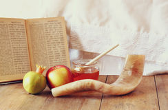Rosh hashanah (jewesh holiday) concept - honey, apple and pomegranate over wooden table. traditional holiday symbols. Royalty Free Stock Photography
