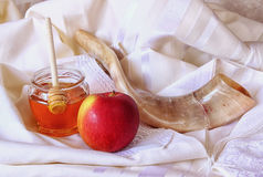 Rosh hashanah (jewesh holiday) concept - honey, apple and pomegranate over wooden table. traditional holiday symbols. Royalty Free Stock Photos