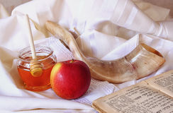 Rosh hashanah (jewesh holiday) concept - honey, apple and pomegranate over wooden table. traditional holiday symbols. Royalty Free Stock Photo