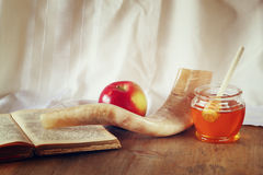 Rosh hashanah (jewesh holiday) concept - honey, apple and pomegranate over wooden table. traditional holiday symbols. Stock Images