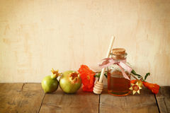 Rosh hashanah (jewesh holiday) concept - honey, apple and pomegranate over wooden table. traditional holiday symbols. Royalty Free Stock Image