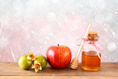 Rosh hashanah (jewesh holiday) concept - honey, apple and pomegranate over wooden table. traditional holiday symbols. Royalty Free Stock Images