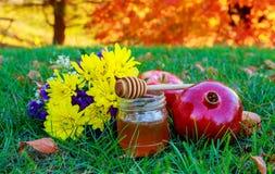 rosh hashanah jewesh holiday concept - honey, apple and pomegranate traditional symbols. Stock Photography