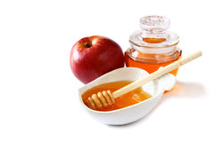 Rosh hashanah (jewesh holiday) concept - honey and red apple isolated on white. traditional holiday symbols. Stock Photos