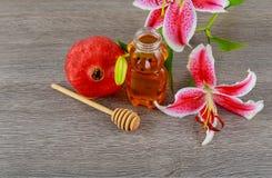 Rosh hashanah jewesh holiday concept - pomegranate honey pink lilies jewish food, symbol,. Jewish food, Jewish Holiday, Holiday symbol, rosh hashanah jewesh royalty free stock photo