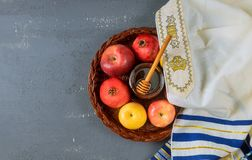 Rosh hashanah jewesh holiday concept - shofar, honey, apple and pomegranate over wooden table. Rosh hashanah jewesh holiday concept shofar, honey, apple and stock images