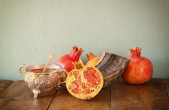 Rosh hashanah (jewesh holiday) concept - shofar, honey, apple and pomegranate over wooden table. traditional holiday symbols. Royalty Free Stock Photos