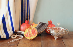 Rosh hashanah (jewesh holiday) concept - shofar, honey, apple and pomegranate over wooden table. traditional holiday symbols. Royalty Free Stock Photography