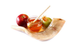 Rosh hashanah (jewesh holiday) concept - shofar (horn), honey, apple and pomegranate isolated on white. traditional holiday symbol Stock Photography