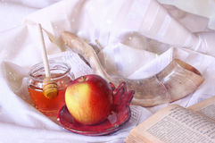 Rosh hashanah (jewesh holiday) concept - shofar, torah book, honey, apple and pomegranate over wooden table. traditional holiday s Stock Photo