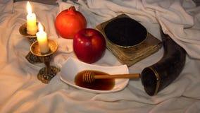 Rosh hashanah jewesh holiday concept shofar, torah book, honey, apple and pomegranate. traditional holiday symbols.4k stock video