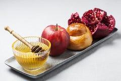 Rosh hashanah. Jewish holiday concept: honey, apple and pomegranate Stock Photography