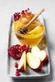 Rosh hashanah. Jewish holiday concept: honey, apple and pomegranate Stock Photo
