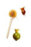 Rosh hashanah (jewish holiday) concept - honey and pomegranate on white. traditional holiday symbols. Stock Photos