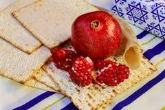 Rosh hashanah jewish holiday matzoh passover bread Pomegranate. Pomegranate and glass of red wine close-up on mat Stock Photo
