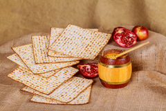 Rosh hashanah jewish holiday matzoh passover bread Pomegranate. Pomegranate and glass of red wine close-up on mat Royalty Free Stock Photos