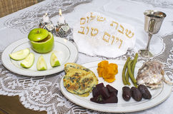 Rosh Hashanah Jewish Holiday Seder Table. Jewish New Year - Rosh Hashanah , apple with honey, candles ,challah , wine cup and blessings on the Seder table Stock Photo