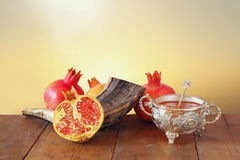 Rosh hashanah (jewish New Year) concept. Traditional symbol. Rosh hashanah (jewish New Year holiday) concept - shofar (horn) and pomegranates over wooden table Stock Image