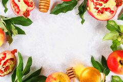 Rosh hashanah jewish New Year holiday concept. Traditional symbol. Apples, honey, pomegranate. Copy space. Top view. Flat lay. stock photos