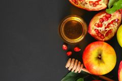 Rosh hashanah jewish New Year holiday concept. Traditional symbol. Apples, honey, pomegranate. Copy space. Top view. Flat lay. Rosh hashanah jewish New Year royalty free stock images