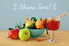 Rosh hashanah & x28;jewish New Year holiday& x29; concept. Traditional symbols. Text SHANA TOVA means HAPPY NEW YEAR in hebrew Royalty Free Stock Photos