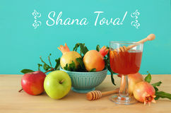 Rosh hashanah & x28;jewish New Year holiday& x29; concept. Traditional symbols. Text SHANA TOVA means HAPPY NEW YEAR in hebrew Stock Images
