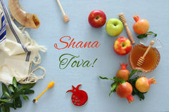 Rosh hashanah & x28;jewish New Year holiday& x29; concept. Traditional symbols. Text SHANA TOVA means HAPPY NEW YEAR in hebrew Royalty Free Stock Photography