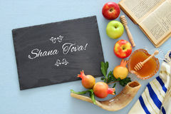 Rosh hashanah & x28;jewish New Year holiday& x29; concept. Traditional symbols. Text SHANA TOVA means HAPPY NEW YEAR in hebrew stock photography