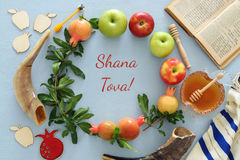 Rosh hashanah & x28;jewish New Year holiday& x29; concept. Traditional symbols. Text SHANA TOVA means HAPPY NEW YEAR in hebrew Royalty Free Stock Photo