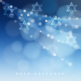 Rosh Hashanah, Jewish New Year holiday or Hannukah greeting card with lights and Jewish stars. Modern blurred  Stock Photography