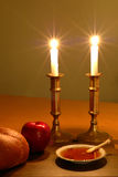 Rosh Hashanah Scene. Candles, apple and honey and challah; the traditional icons of the Jewish New Year Stock Photos